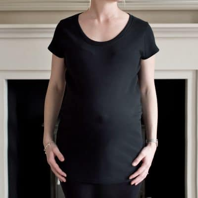 Closeup of plain black maternity top
