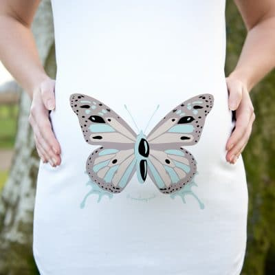 Model wearing a butterly design maternity top by Gooseberry Pink