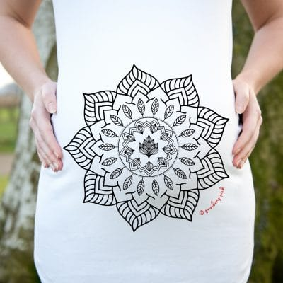 Model wearing white maternity top with mandala design by Gooseberry Pink