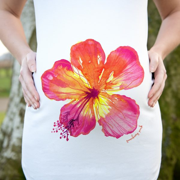 Model wearing white maternity top with tropical flower design