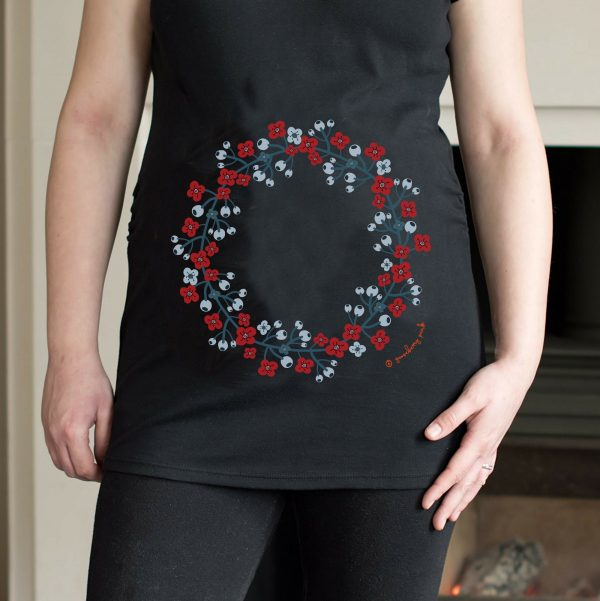 Model wearing black maternity top with garland design