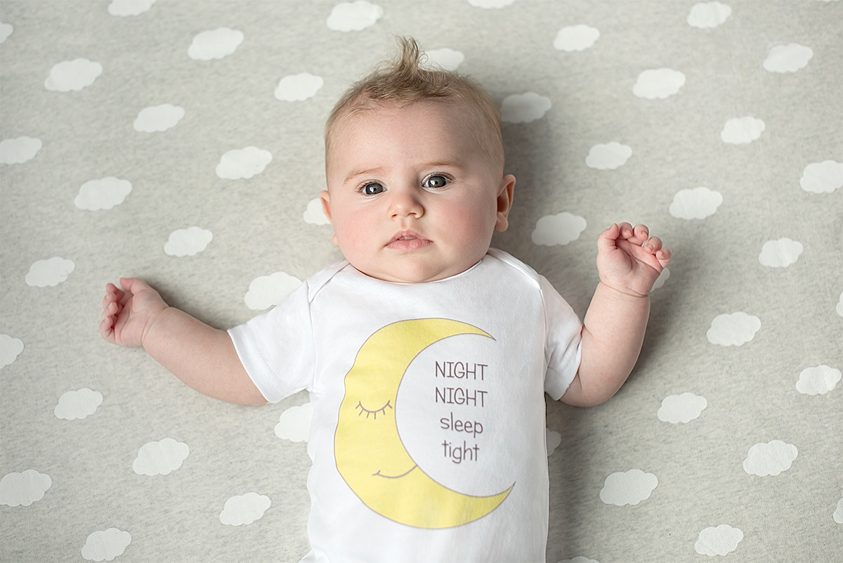 Baby wearing moon design bodysuit by Gooseberry Pink