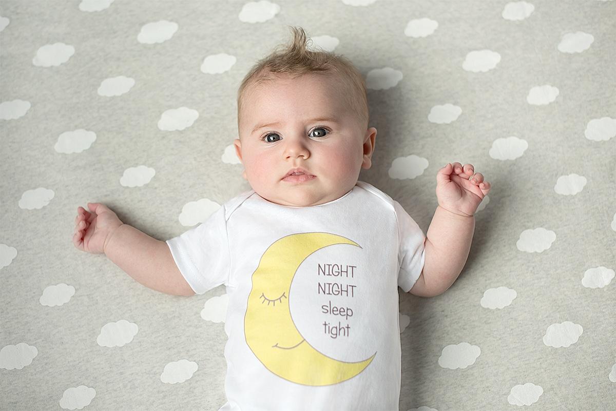 Baby wearing moon design bodysuit by Gooseberry Pink