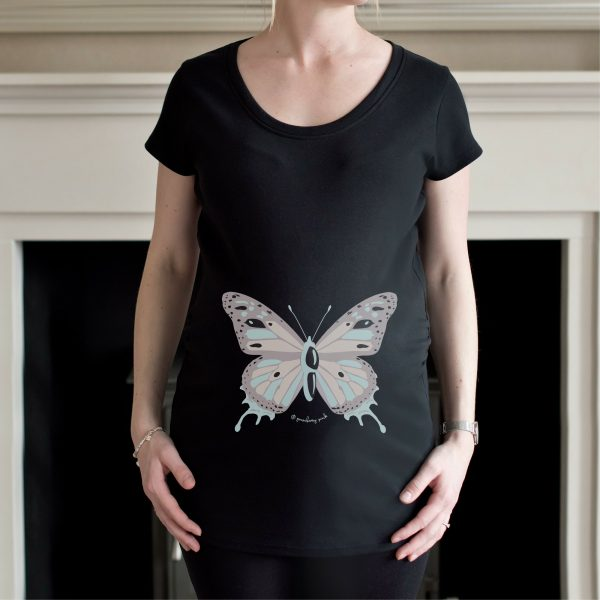 Pregnant model wearing black maternity top from Gooseberry Pink with butterfly design