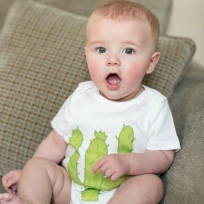 Baby wearing Cactus Baby Bodysuit in white organic cotton