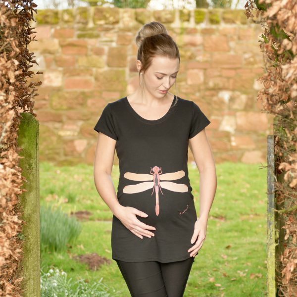 Girl wearing dragonfly maternity top by Gooseberry Pink