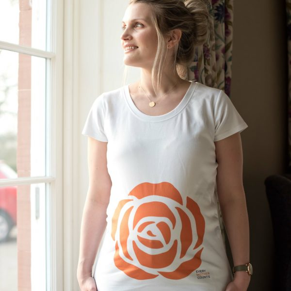Pregnant girl wearing white organic maternity top featuring Every Mother Counts Orange Rose Logo
