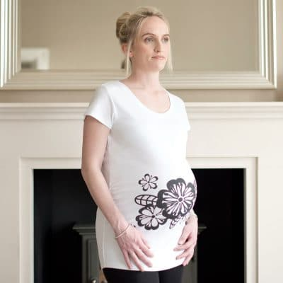 Pregnant girl wearing floral maternity top by Gooseberry Pink