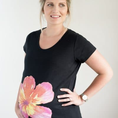 Pregnant girl wearing tropical flower maternity top by Gooseberry Pink