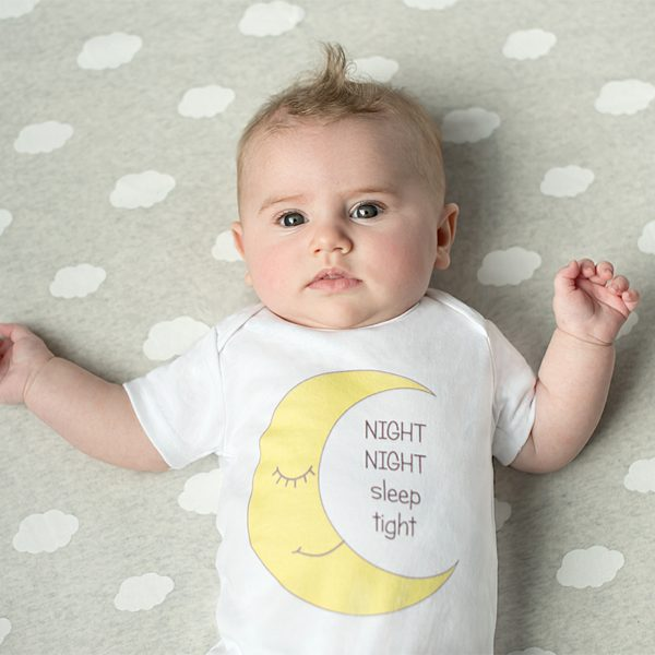 Baby wearing white organic t-shirt with moon design by Gooseberry Pink