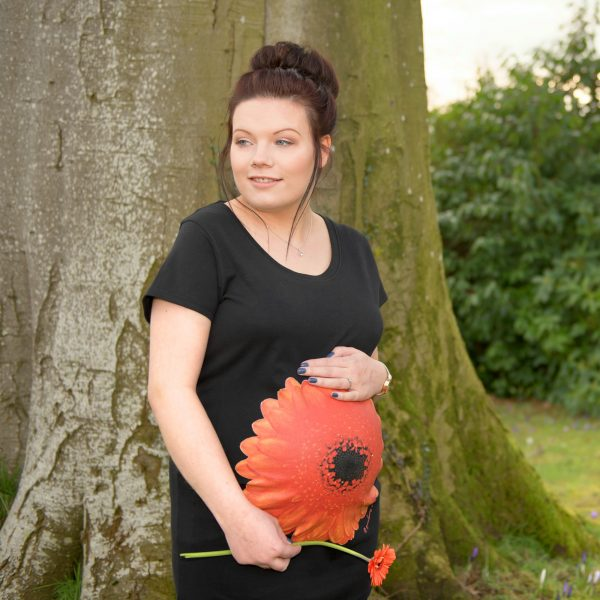 Girl wearing black organic cotton orange gerbera maternity top by Gooseberry PInk