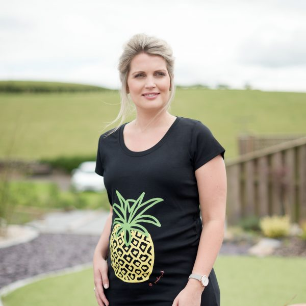 Expectant mum modelling black organic pineapple maternity top by Gooseberry Pink