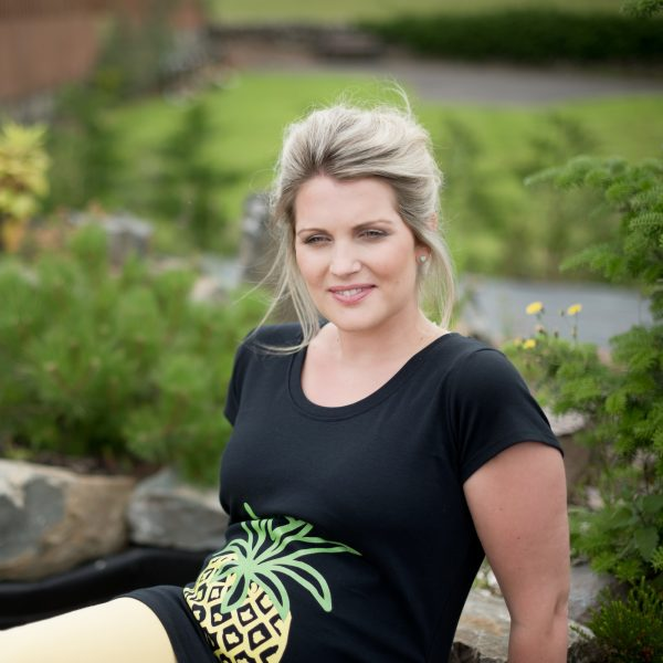 Smiling girl wearing pineapple maternity top by Gooseberry Pink