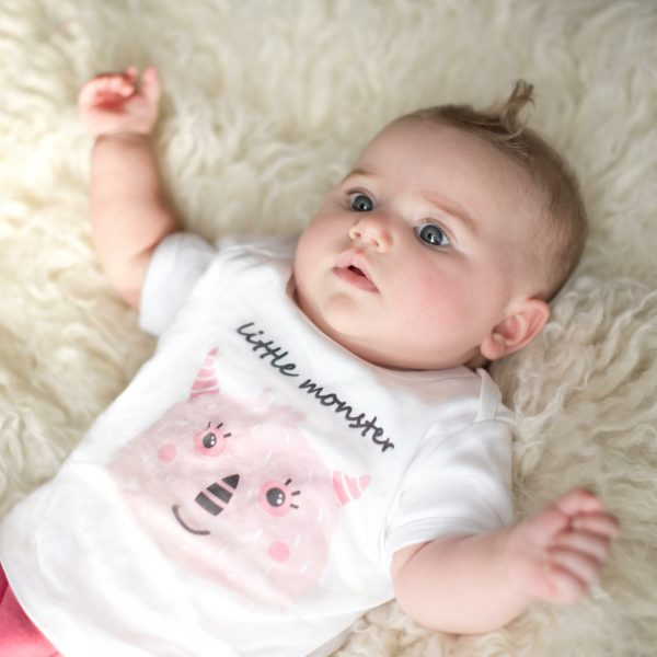 BBaby girl wearing white organic baby bodysuit with pink monster design by Gooseberry Pink