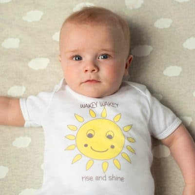 Baby wearing sun baby tshirt by Gooseberry Pink