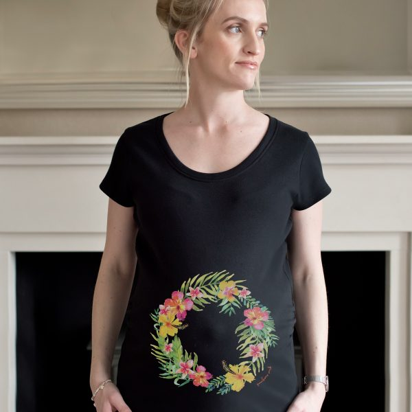 Model wearing tropical garland maternity top design by Gooseberry Pink