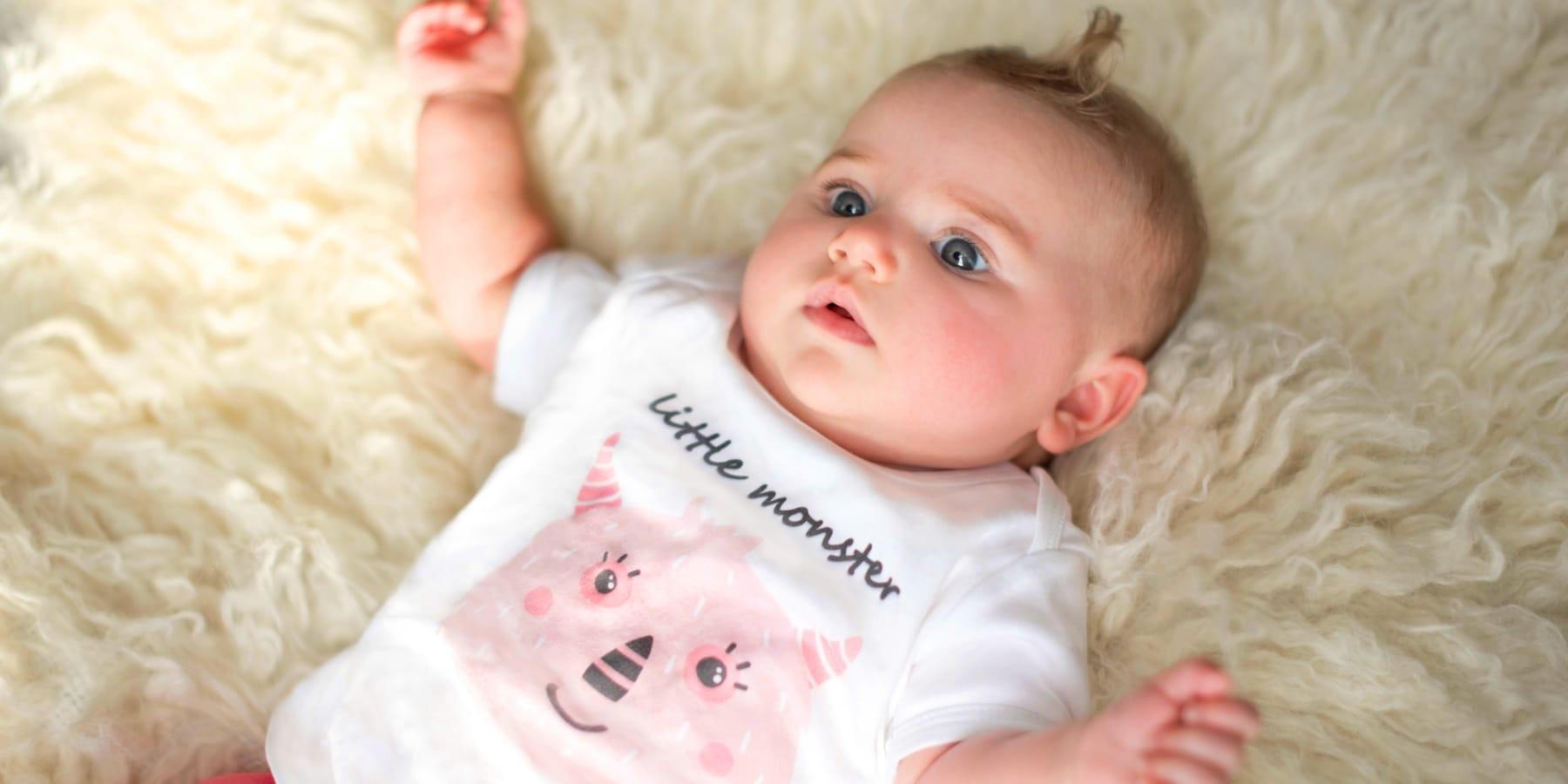 Baby girl wearing gooseberry pink organic baby clothing