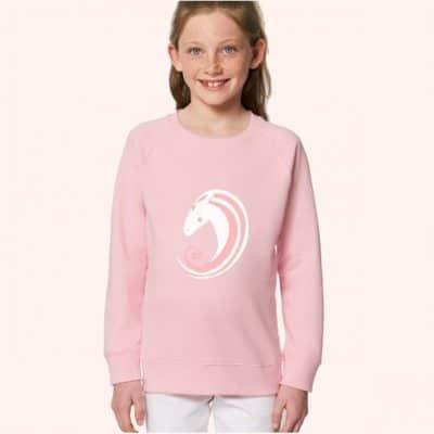Girl wearing unicorn sweatshirt